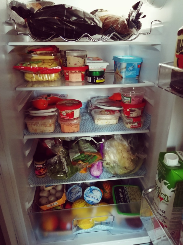 open fridge with food and different brands